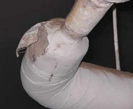 Asbestos management surveys - Torn asbestos pipe lagging