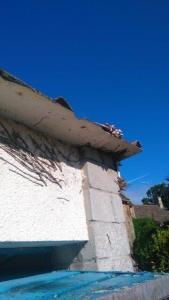 How to remove asbestos from a shed or garage - a garage with an asbestos roof